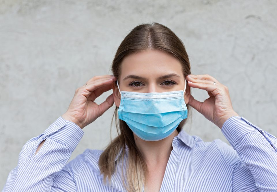 Young caucasian woman wearing surgical mask - coronavirus quarantine